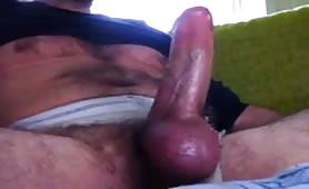 Smoking daddy jerks off his big cock & cums