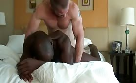 Muscled white dude wallowing a horny black