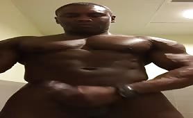 Huge black dude wanking his monster cock