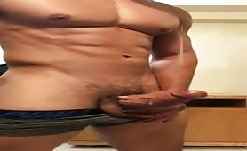 Muscular hot stud showing his huge cock