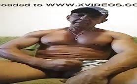 Well-groomed muscular mature man masturbates solo