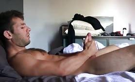 Muscled cute guy masturbates very big dick