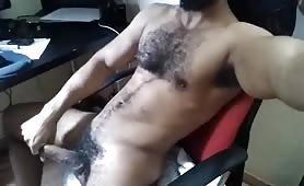 Cute hairy latino enjoys playing with his huge cock