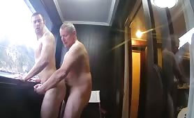 Older daddy bareback fucking his young boy toy on a boat