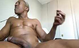 Old black dad smoking and stroking his cock