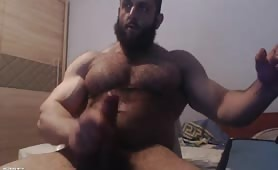Big strong muscle guy stroking his cock on webcam