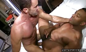 Sexy muscled stud nailing a cute black ass