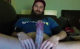 Bearded dude happy to show his huge cock on webcam
