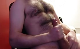 Hairy guy masturbating until he shoots a load