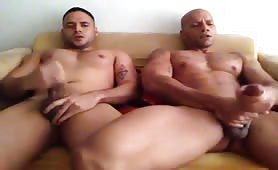 Two horny Dominican guys competing to see who throws a bigger load
