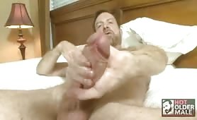 Mature having fun solo on his bed