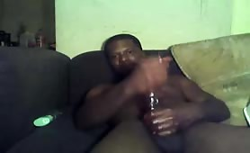 Mature black guy strokes his huge fat meaty cock on his sofa solo