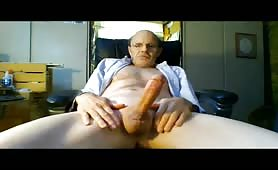 Old guy stroking his huge fat cock