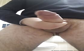 Hairy huge cock guy masturbating in a public toilet