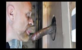 White dude sucking a huge dominican cock thru a glory hole