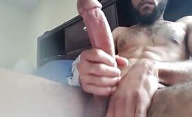 Bearded arab dude stroking his huge piece of meat