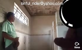 Horny latinos jerking off in a public toilet