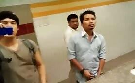 Asian guy cuming in a public bathroom