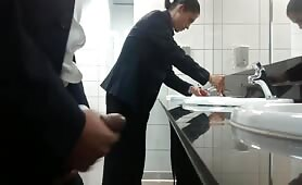 Horny salesman strokes his cock in a public toilet in front of every one