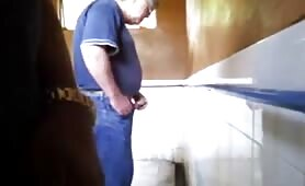 Spying on horny guys stroking their cocks while they piss