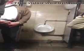 Spying on guys masturbating in public toilets