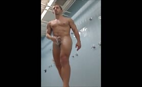 Hot guy stroking his cock in public shower