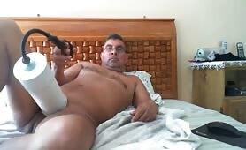 Horny latin dad using a huge pump to masturbate