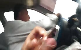 Cumming next to the taxi driver