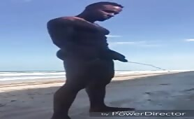 Pissing nude ath the beach