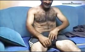 this handsome hairy bIg cock daddy jerking his huge cock