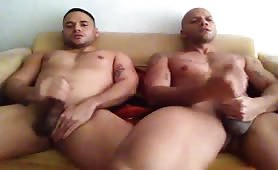 two friends with a huge cock relaxing and masturbating